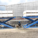 Применение подъемных столов на складах
